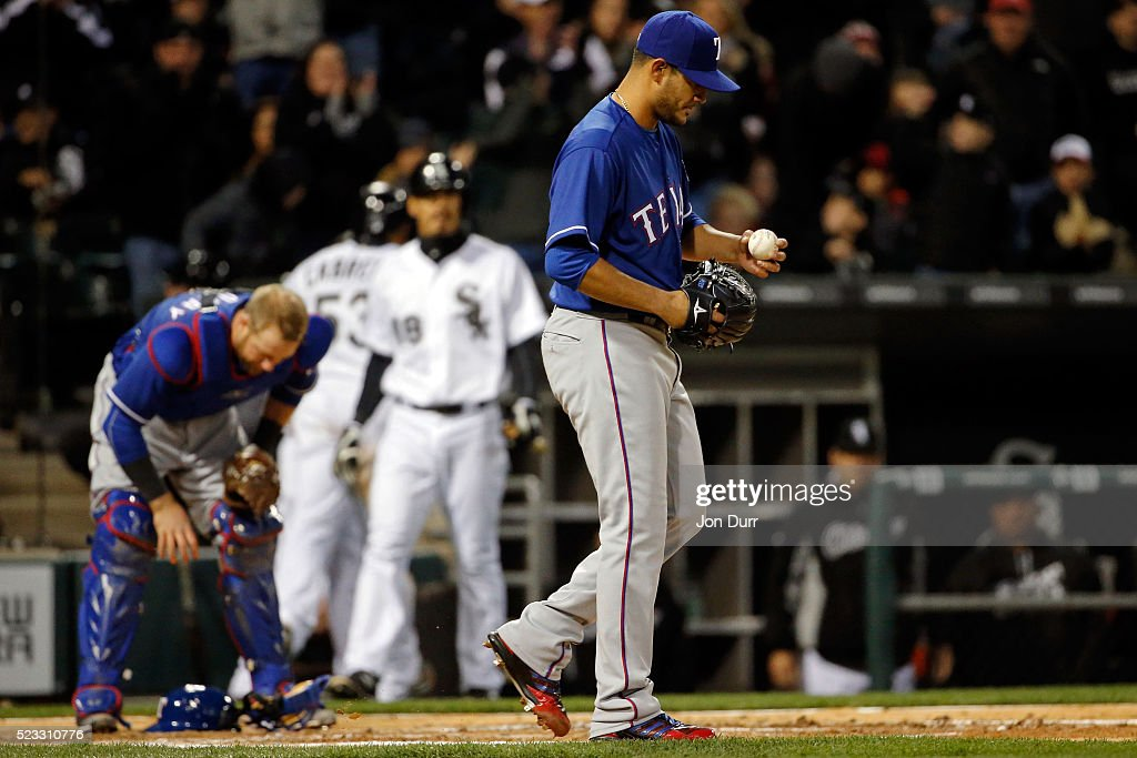 Martin Perez #33 of the Texas Rangers reacts after <a gi-track='captionPersonalityLinkClicked' href=/galleries/search?phrase=Melky+Cabrera&family=editorial&specificpeople=453444 ng-click='$event.stopPropagation()'>Melky Cabrera</a> #53 of the Chicago White Sox (not pictured) stole home plate after throwing a wild pitch during the second inning at U.S. Cellular Field on April 22, 2016 in Chicago, Illinois.