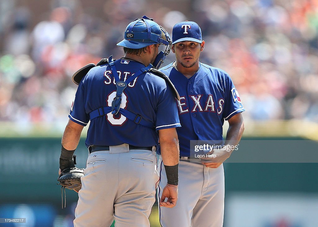 Martin Perez #33 of the Texas Rangers talks with his catcher <a gi-track='captionPersonalityLinkClicked' href=/galleries/search?phrase=Geovany+Soto&family=editorial&specificpeople=743668 ng-click='$event.stopPropagation()'>Geovany Soto</a> #8 during the sixth inning of the game against the Detroit Tigers at Comerica Park on July 14, 2013 in Detroit, Michigan. The Tigers defeated the Rangers 5-0.