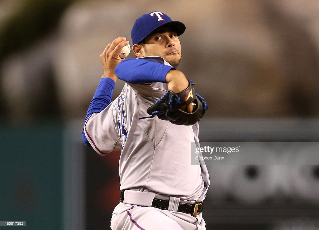 Martin Perez #33 of the Texas Rangers throws a pitch against the Los Angeles Angels of Anaheim at Angel Stadium of Anaheim on September 4, 2015 in Anaheim, California
