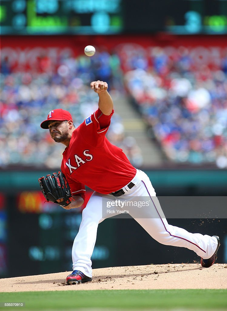 Martin Perez #33 of the Texas Rangers throws in the first inning against the Pittsburgh Pirates at Globe Life Park in Arlington on May 29, 2016 in Arlington, Texas.