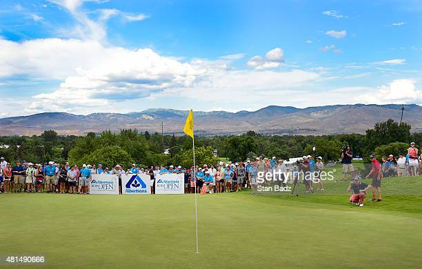 Martin Piller far right studies his putt on the 18th green during the final round of the Webcom Tour Albertsons Boise Open presented by Kraft Nabisco...
