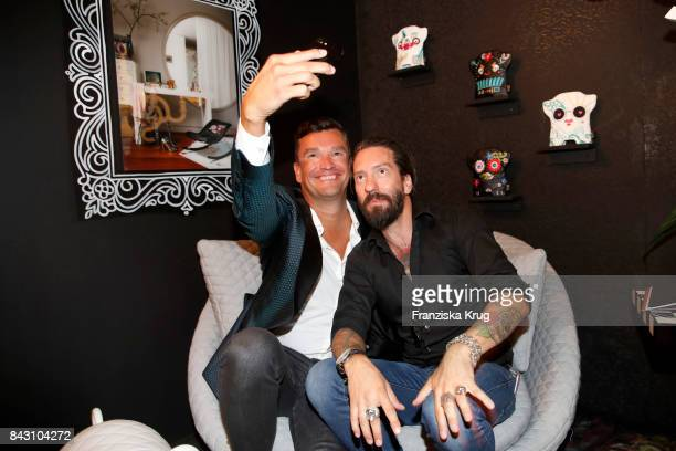Martin Pos and singer Alec Voelkel during the Cybex Fashion Cocktail on September 5 2017 in Berlin Germany