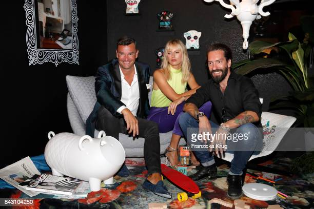 Martin Pos supermodel and actress Karolina Kurkova and singer Alec Voelkel during the Cybex Fashion Cocktail on September 5 2017 in Berlin Germany
