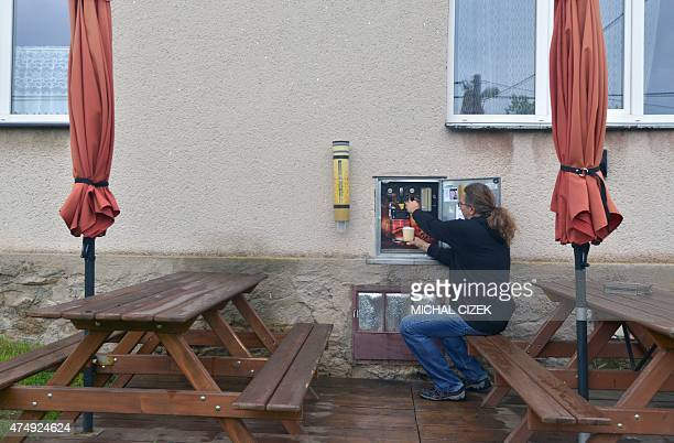 Martin Povysil 50 year old former salesman for a mediumsized Czech brewery drafts a beer from his mechanic selfservice pub on May 26 2015 in...