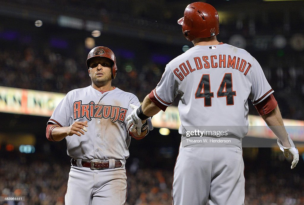 Martin Prado #14 and Paul Goldschmidt #44 of the Arizona Diamondbacks celebrate after they both scored on a two-run double from Miguel Montero #26 (not pictured) against the San Francisco Giants in the top of the third inning at AT&T Park on April 10, 2014 in San Francisco, California.