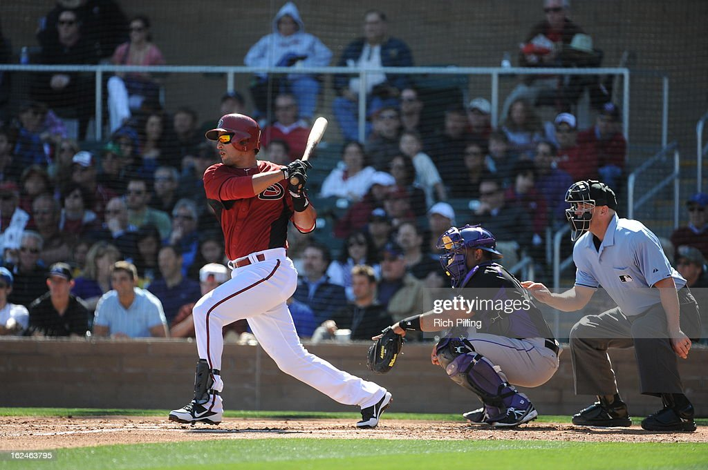 <a gi-track='captionPersonalityLinkClicked' href=/galleries/search?phrase=Martin+Prado&family=editorial&specificpeople=620159 ng-click='$event.stopPropagation()'>Martin Prado</a> #14 of the Arizona Diamondbacks bats during the game against the Colorado Rockies on February 23, 2013 at the Salt River Fields at Talking Stick in Scottsdale, Arizona. The Rockies defeated the Diamondbacks 11-2.