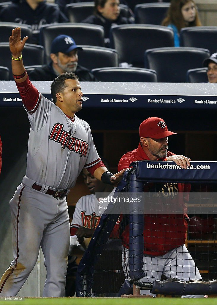 <a gi-track='captionPersonalityLinkClicked' href=/galleries/search?phrase=Martin+Prado&family=editorial&specificpeople=620159 ng-click='$event.stopPropagation()'>Martin Prado</a> #14 of the Arizona Diamondbacks celebrates as runners score in the 12 inning against the New York Yankees on April 18, 2013 at Yankee Stadium in the Bronx borough of New York City.The Arizona Diamondbacks defeated the New York Yankees 6-2 in 12 innings.