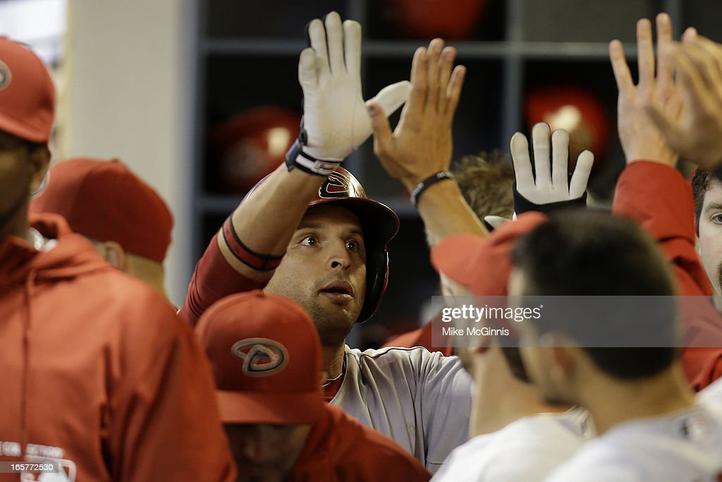 Martin Prado #14 of the Arizona Diamondbacks celebrates in the dugout after scoring on a double off the bat of Paul Goldschmidt in the top of the fourth inning against the Milwaukee Brewers at Miller Park on April 5, 2013 in Milwaukee, Wisconsin.