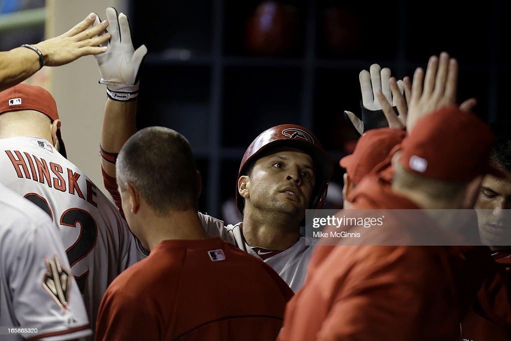 <a gi-track='captionPersonalityLinkClicked' href=/galleries/search?phrase=Martin+Prado&family=editorial&specificpeople=620159 ng-click='$event.stopPropagation()'>Martin Prado</a> #14 of the Arizona Diamondbacks celebrates in the dugout after getting hit home by Miguel Montero in the top of the first inning against the Milwaukee Brewers at Miller Park on April 6, 2013 in Milwaukee, Wisconsin.