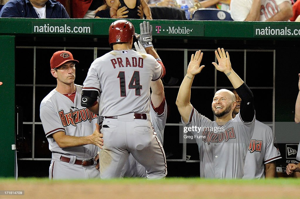 Martin Prado #14 of the Arizona Diamondbacks celebrates with teammates after hitting a home run in the eighth inning against the Washington Nationals at Nationals Park on June 25, 2013 in Washington, DC.