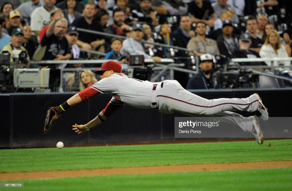 <a gi-track='captionPersonalityLinkClicked' href=/galleries/search?phrase=Martin+Prado&family=editorial&specificpeople=620159 ng-click='$event.stopPropagation()'>Martin Prado</a> #14 of the Arizona Diamondbacks dives but can't make the catch on on a foul ball hit by Jesus Guzman (not pictured) of the San Diego Padres during the eighth inning of a baseball game at Petco Park on September 24, 2013 in San Diego, California.