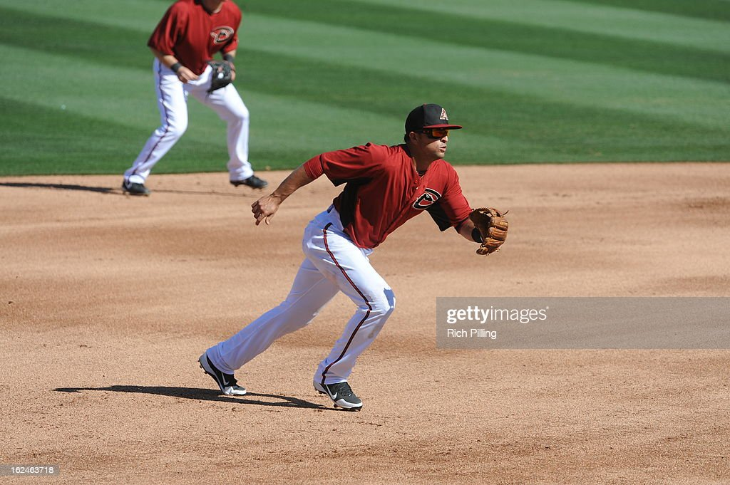 <a gi-track='captionPersonalityLinkClicked' href=/galleries/search?phrase=Martin+Prado&family=editorial&specificpeople=620159 ng-click='$event.stopPropagation()'>Martin Prado</a> #14 of the Arizona Diamondbacks fields during the game against the Colorado Rockies on February 23, 2013 at the Salt River Fields at Talking Stick in Scottsdale, Arizona. The Rockies defeated the Diamondbacks 11-2.