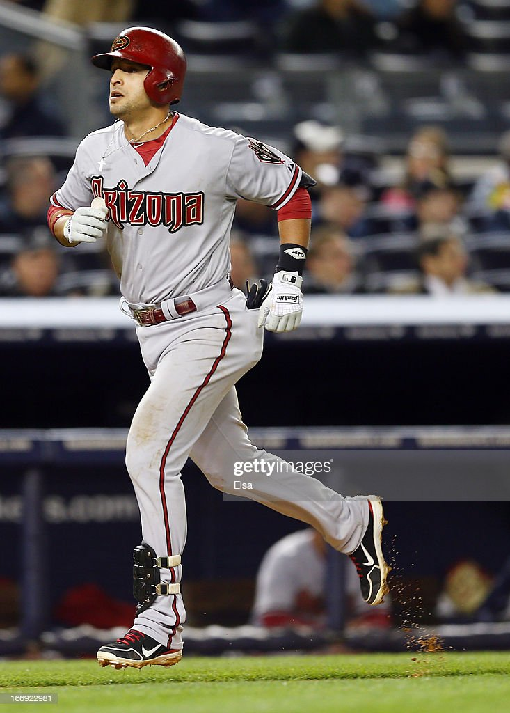 Martin Prado #14 of the Arizona Diamondbacks heads for home after he hit a solo home run in the sixth inning off a pitch from Phil Hughes of the New York Yankees on April 18, 2013 at Yankee Stadium in the Bronx borough of New York City.