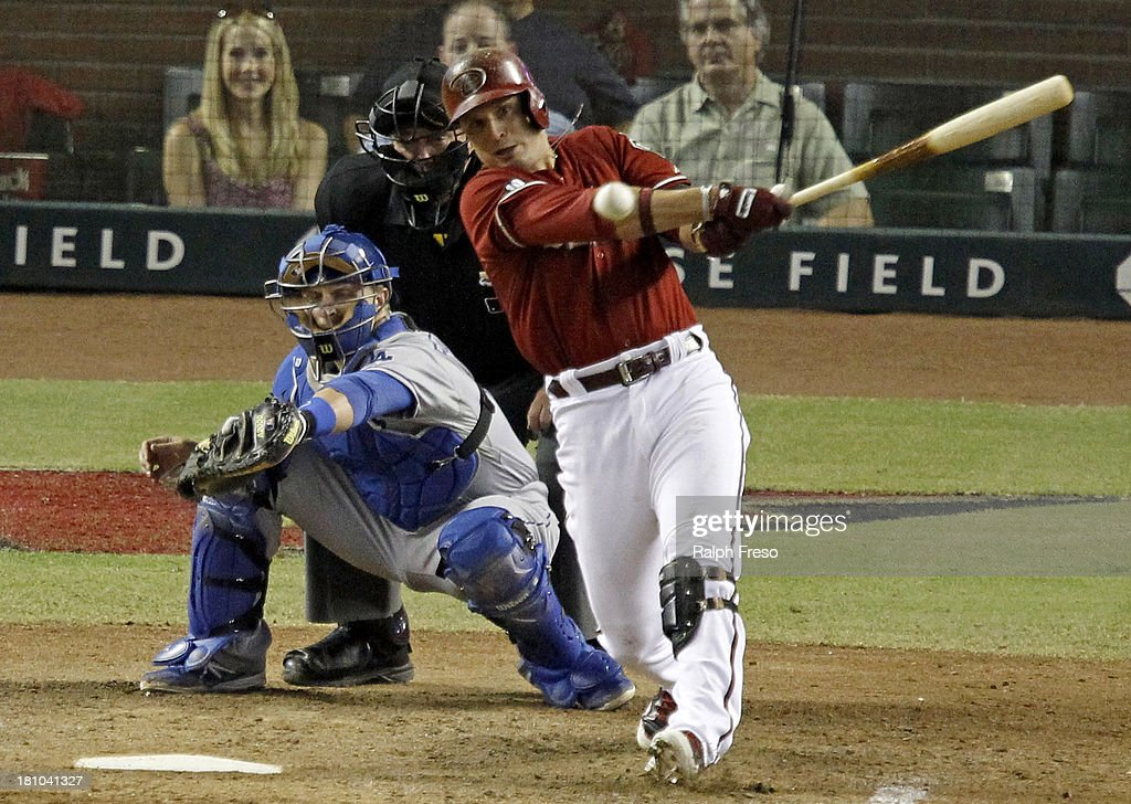 <a gi-track='captionPersonalityLinkClicked' href=/galleries/search?phrase=Martin+Prado&family=editorial&specificpeople=620159 ng-click='$event.stopPropagation()'>Martin Prado</a> #14 of the Arizona Diamondbacks hits a double to left field against the Los Angeles Dodgers during the eighth inning of a MLB game at Chase Field on September 18, 2013 in Phoenix, Arizona.