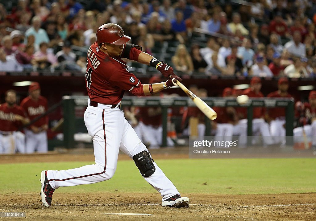 <a gi-track='captionPersonalityLinkClicked' href=/galleries/search?phrase=Martin+Prado&family=editorial&specificpeople=620159 ng-click='$event.stopPropagation()'>Martin Prado</a> #14 of the Arizona Diamondbacks hits a RBI double against the Los Angeles Dodgers during the MLB game at Chase Field on September 18, 2013 in Phoenix, Arizona. The Diamondbacks defeated the Dodgers 9-4.