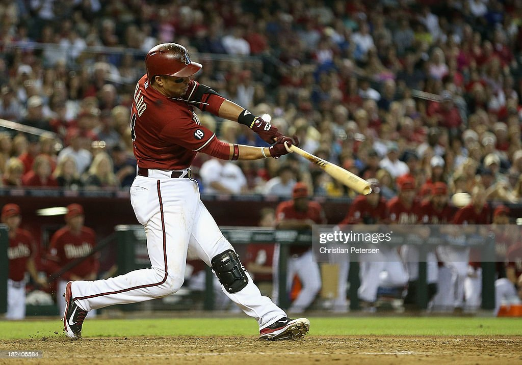 <a gi-track='captionPersonalityLinkClicked' href=/galleries/search?phrase=Martin+Prado&family=editorial&specificpeople=620159 ng-click='$event.stopPropagation()'>Martin Prado</a> #14 of the Arizona Diamondbacks hits a RBI single against the Washington Nationals during the eighth inning of the MLB game at Chase Field on September 29, 2013 in Phoenix, Arizona. The Diamondbacks defeated the Nationals 3-2.