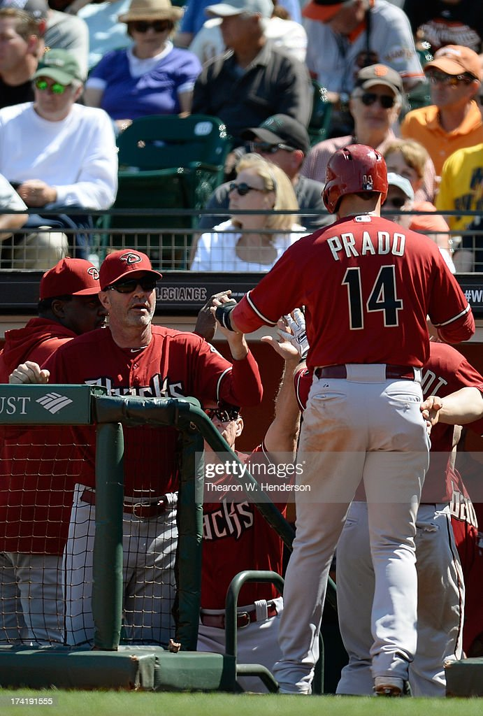 <a gi-track='captionPersonalityLinkClicked' href=/galleries/search?phrase=Martin+Prado&family=editorial&specificpeople=620159 ng-click='$event.stopPropagation()'>Martin Prado</a> #14 of the Arizona Diamondbacks is congratulated by manager <a gi-track='captionPersonalityLinkClicked' href=/galleries/search?phrase=Kirk+Gibson&family=editorial&specificpeople=207042 ng-click='$event.stopPropagation()'>Kirk Gibson</a> #23 after Prado scored in the eighth inning against the San Francisco Giants at AT&T Park on July 21, 2013 in San Francisco, California.