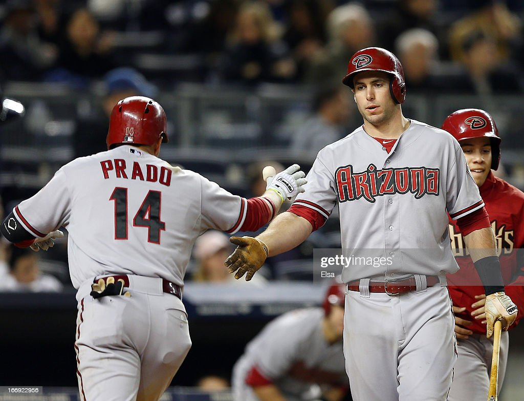 Martin Prado #14 of the Arizona Diamondbacks is congratulated by teammates Paul Goldschmidt #33 after Prado hit a solo home run in the sixth inning off a pitch from Phil Hughes of the New York Yankees on April 18, 2013 at Yankee Stadium in the Bronx borough of New York City.