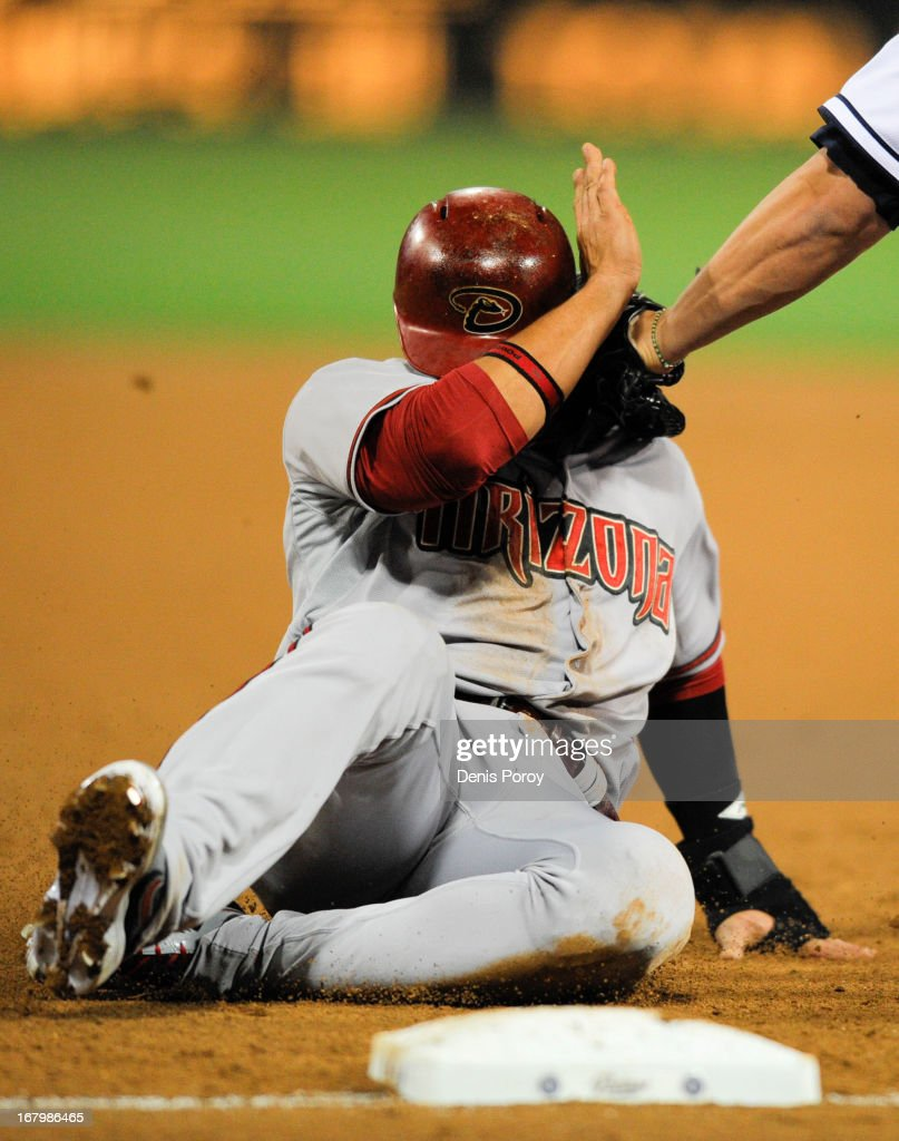 <a gi-track='captionPersonalityLinkClicked' href=/galleries/search?phrase=Martin+Prado&family=editorial&specificpeople=620159 ng-click='$event.stopPropagation()'>Martin Prado</a> #14 of the Arizona Diamondbacks is tagged out at first base by <a gi-track='captionPersonalityLinkClicked' href=/galleries/search?phrase=Yonder+Alonso&family=editorial&specificpeople=4424898 ng-click='$event.stopPropagation()'>Yonder Alonso</a> #23 of the San Diego Padres in the third inning of a baseball game at Petco Park on May 3, 2013 in San Diego, California.