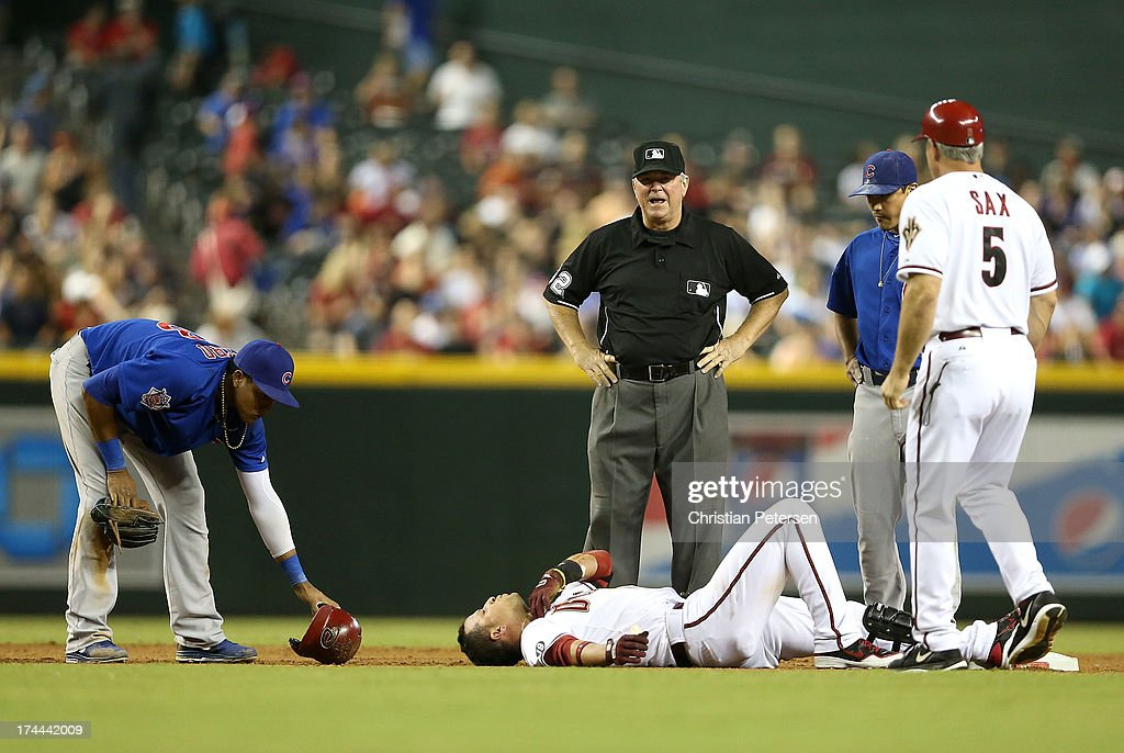 <a gi-track='captionPersonalityLinkClicked' href=/galleries/search?phrase=Martin+Prado&family=editorial&specificpeople=620159 ng-click='$event.stopPropagation()'>Martin Prado</a> #14 of the Arizona Diamondbacks lays on the ground near second base after a collision with infielder <a gi-track='captionPersonalityLinkClicked' href=/galleries/search?phrase=Starlin+Castro&family=editorial&specificpeople=5970945 ng-click='$event.stopPropagation()'>Starlin Castro</a> #13 of the Chicago Cubs during the fifth inning of the MLB game at Chase Field on July 25, 2013 in Phoenix, Arizona.