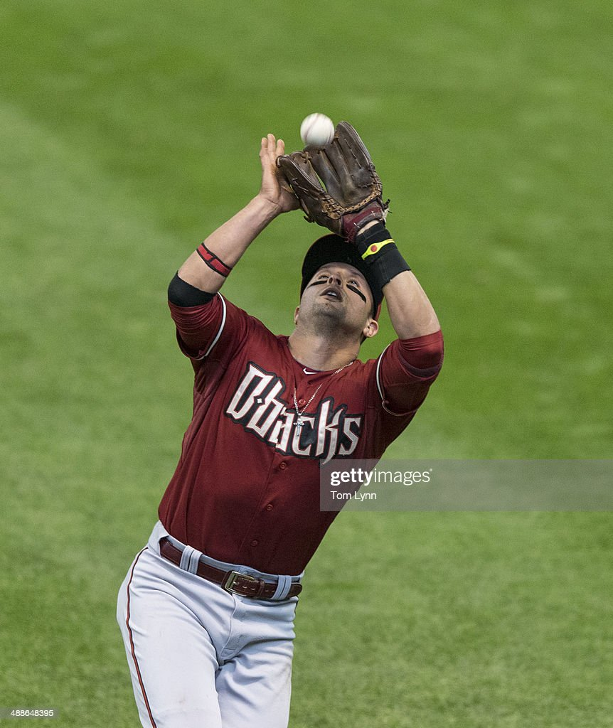 <a gi-track='captionPersonalityLinkClicked' href=/galleries/search?phrase=Martin+Prado&family=editorial&specificpeople=620159 ng-click='$event.stopPropagation()'>Martin Prado</a> #14 of the Arizona Diamondbacks makes a catch against the Milwaukee Brewers at Miller Park on May 7, 2014 in Milwaukee, Wisconsin.
