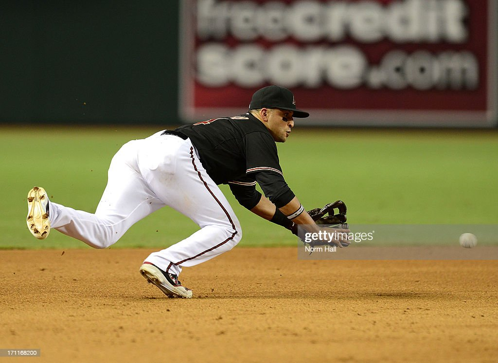 <a gi-track='captionPersonalityLinkClicked' href=/galleries/search?phrase=Martin+Prado&family=editorial&specificpeople=620159 ng-click='$event.stopPropagation()'>Martin Prado</a> #14 of the Arizona Diamondbacks makes a diving play against the Cincinnati Reds at Chase Field on June 22, 2013 in Phoenix, Arizona.
