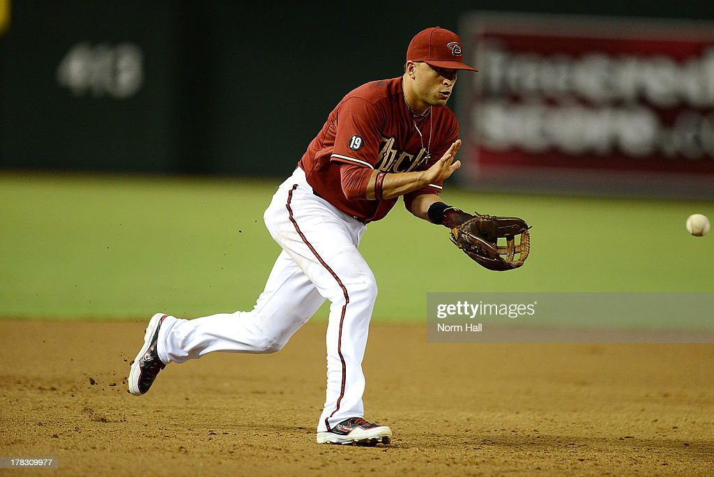 <a gi-track='captionPersonalityLinkClicked' href=/galleries/search?phrase=Martin+Prado&family=editorial&specificpeople=620159 ng-click='$event.stopPropagation()'>Martin Prado</a> #14 of the Arizona Diamondbacks makes a play on a bouncing ball against the San Diego Padres at Chase Field on August 28, 2013 in Phoenix, Arizona.