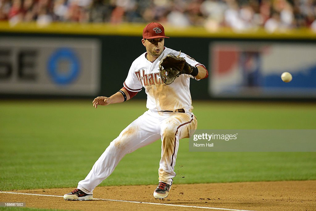 <a gi-track='captionPersonalityLinkClicked' href=/galleries/search?phrase=Martin+Prado&family=editorial&specificpeople=620159 ng-click='$event.stopPropagation()'>Martin Prado</a> #14 of the Arizona Diamondbacks makes a play on a ground ball against the Atlanta Braves at Chase Field on May 13, 2013 in Phoenix, Arizona.
