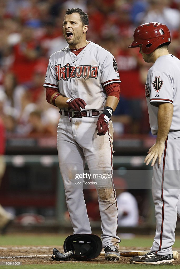 <a gi-track='captionPersonalityLinkClicked' href=/galleries/search?phrase=Martin+Prado&family=editorial&specificpeople=620159 ng-click='$event.stopPropagation()'>Martin Prado</a> #14 of the Arizona Diamondbacks reacts after striking out to end the eighth inning of the game against the Cincinnati Reds at Great American Ball Park on August 19, 2013 in Cincinnati, Ohio. The Reds won 5-3.