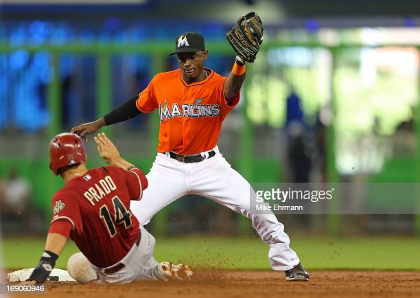 Martin Prado of the Arizona Diamondbacks reacts to being caught stealing by Adeiny Hechavarria of the Miami Marlins during a game at Marlins Park on...