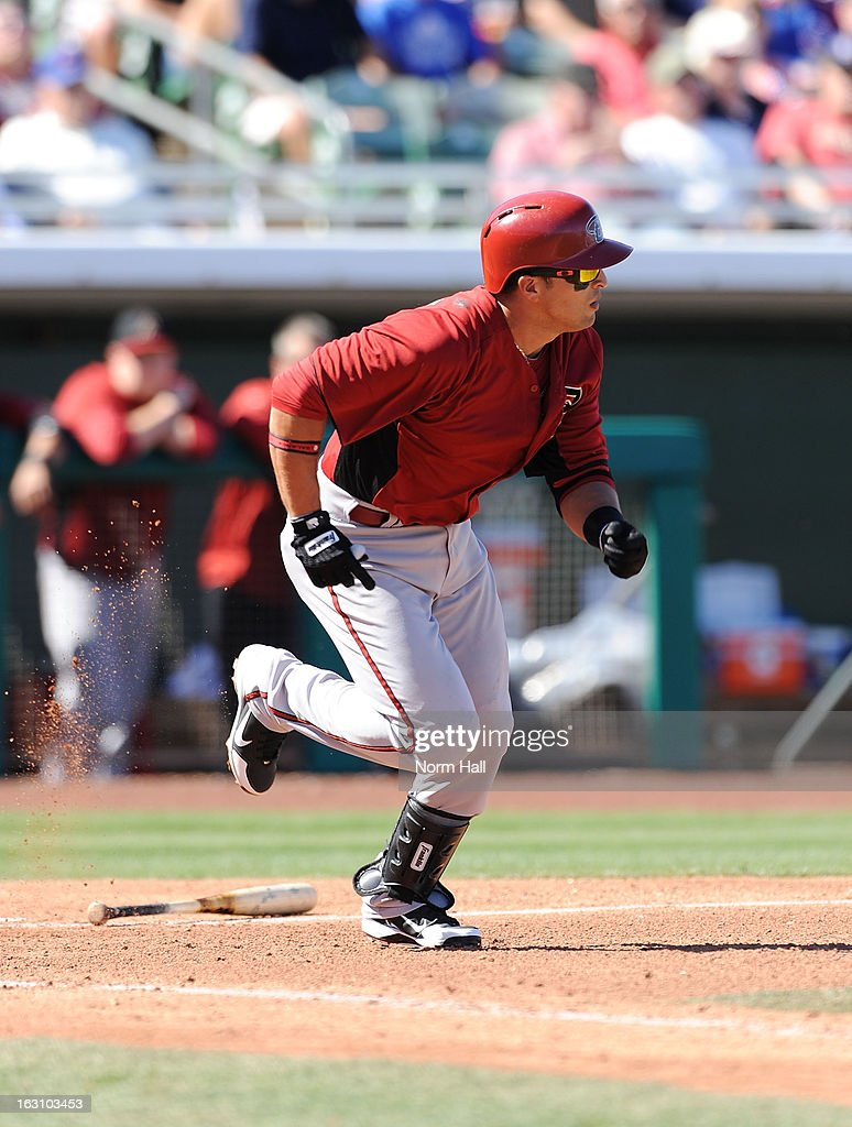 <a gi-track='captionPersonalityLinkClicked' href=/galleries/search?phrase=Martin+Prado&family=editorial&specificpeople=620159 ng-click='$event.stopPropagation()'>Martin Prado</a> #14 of the Arizona Diamondbacks runs out of the batters box against the Chicago Cubs at HoHoKam Park on March 1, 2013 in Mesa, Arizona.