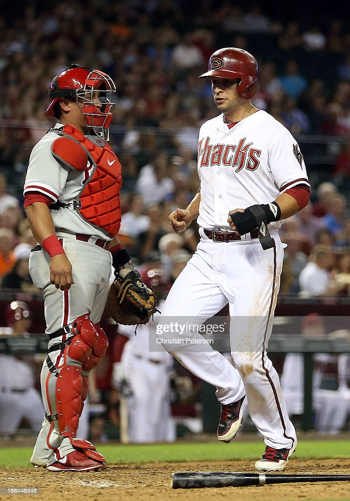 <a gi-track='captionPersonalityLinkClicked' href=/galleries/search?phrase=Martin+Prado&family=editorial&specificpeople=620159 ng-click='$event.stopPropagation()'>Martin Prado</a> #14 of the Arizona Diamondbacks scores a run past catcher Carlos Ruiz #51 of the Philadelphia Phillies during the fifth inning of the MLB game at Chase Field on May 9, 2013 in Phoenix, Arizona.