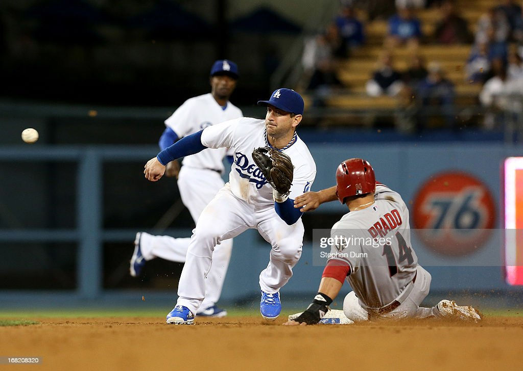 <a gi-track='captionPersonalityLinkClicked' href=/galleries/search?phrase=Martin+Prado&family=editorial&specificpeople=620159 ng-click='$event.stopPropagation()'>Martin Prado</a> #14 of the Arizona Diamondbacks slides into second with a stolen base ahead of the throw to second baseman <a gi-track='captionPersonalityLinkClicked' href=/galleries/search?phrase=Nick+Punto&family=editorial&specificpeople=547246 ng-click='$event.stopPropagation()'>Nick Punto</a> #7 of the Los Angeles Dodgers in the fifth inning at Dodger Stadium on May 6, 2013 in Los Angeles, California.