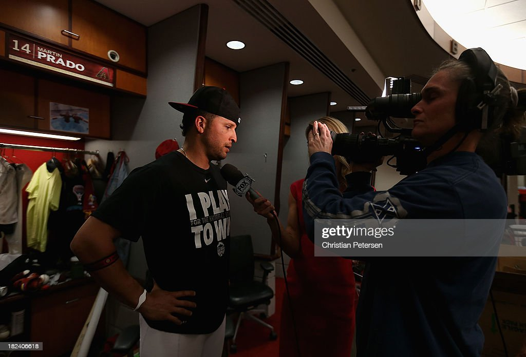 <a gi-track='captionPersonalityLinkClicked' href=/galleries/search?phrase=Martin+Prado&family=editorial&specificpeople=620159 ng-click='$event.stopPropagation()'>Martin Prado</a> #14 of the Arizona Diamondbacks speaks with the media following the MLB game against the Washington Nationals at Chase Field on September 29, 2013 in Phoenix, Arizona. The Diamondbacks defeated the Nationals 3-2.