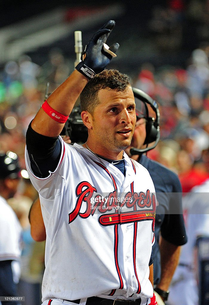 <a gi-track='captionPersonalityLinkClicked' href=/galleries/search?phrase=Martin+Prado&family=editorial&specificpeople=620159 ng-click='$event.stopPropagation()'>Martin Prado</a> #14 of the Atlanta Braves acknowledges the crowd after knocking in the game-winning run in the 11th inning against the San Francisco Giants at Turner Field on August 16, 2011 in Atlanta, Georgia.