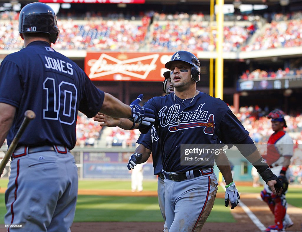 <a gi-track='captionPersonalityLinkClicked' href=/galleries/search?phrase=Martin+Prado&family=editorial&specificpeople=620159 ng-click='$event.stopPropagation()'>Martin Prado</a> #14 of the Atlanta Braves is congratulated by teammate <a gi-track='captionPersonalityLinkClicked' href=/galleries/search?phrase=Chipper+Jones&family=editorial&specificpeople=171256 ng-click='$event.stopPropagation()'>Chipper Jones</a> #10 after scoring on a single by Jason Heyward #22 during the second inning in a MLB baseball game on September 22, 2012 at Citizens Bank Park in Philadelphia, Pennsylvania.