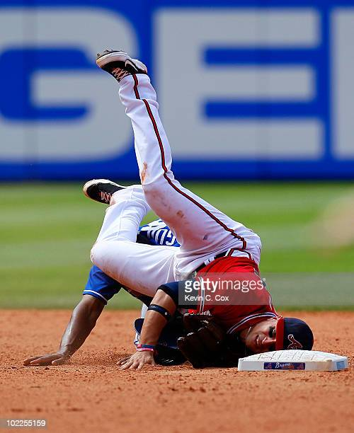 Martin Prado of the Atlanta Braves is upended at second base by Jose Guillen of the Kansas City Royals after attempting to turn a double play at...