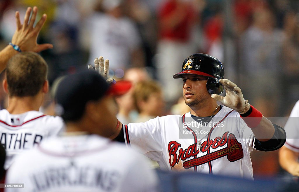 <a gi-track='captionPersonalityLinkClicked' href=/galleries/search?phrase=Martin+Prado&family=editorial&specificpeople=620159 ng-click='$event.stopPropagation()'>Martin Prado</a> #14 of the Atlanta Braves reacts in the sixth inning after hitting a solo homer against the San Diego Padres at Turner Field on June 1, 2011 in Atlanta, Georgia.