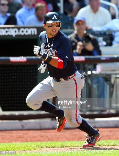 Martin Prado of the Atlanta Braves scores a run against the New York Mets on May 13 2009 at Citi Field in the Flushing neighborhood of the Queens...