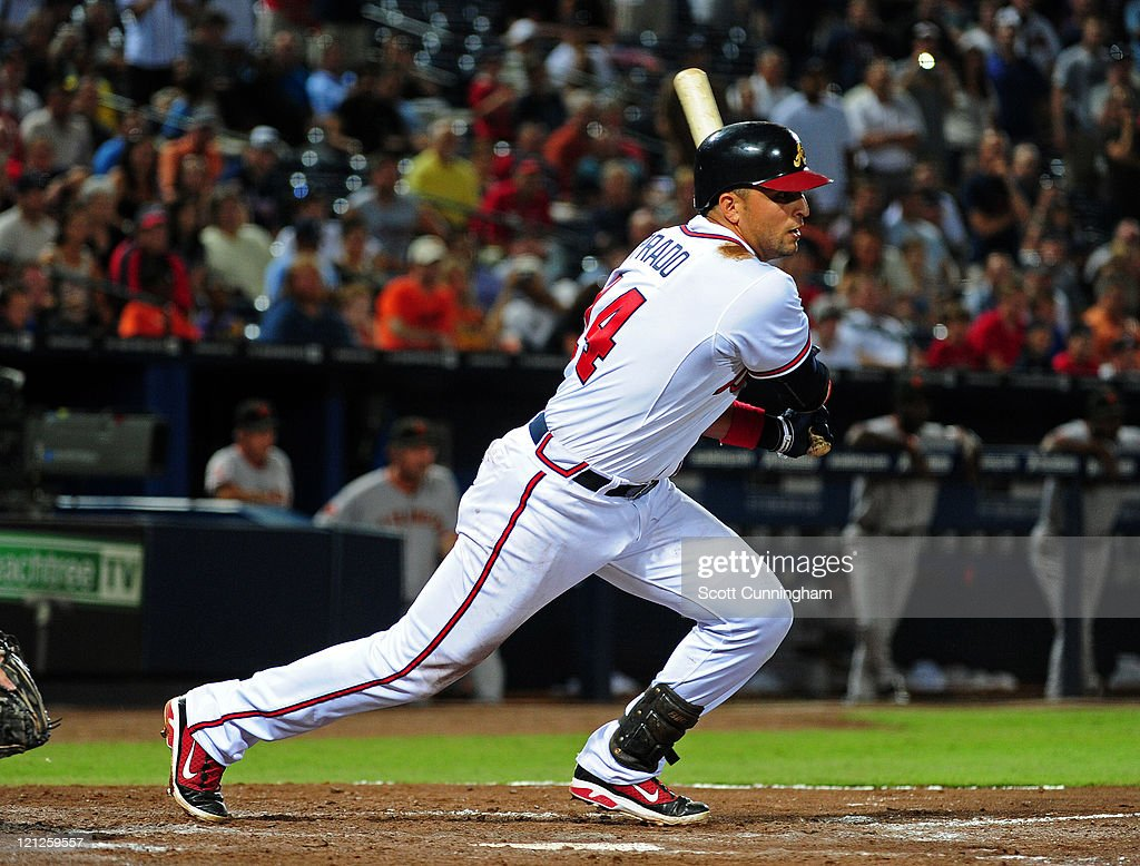 <a gi-track='captionPersonalityLinkClicked' href=/galleries/search?phrase=Martin+Prado&family=editorial&specificpeople=620159 ng-click='$event.stopPropagation()'>Martin Prado</a> #14 of the Atlanta Braves singles in the 11th inning to knock in the game-winning run against the San Francisco Giants at Turner Field on August 16, 2011 in Atlanta, Georgia.