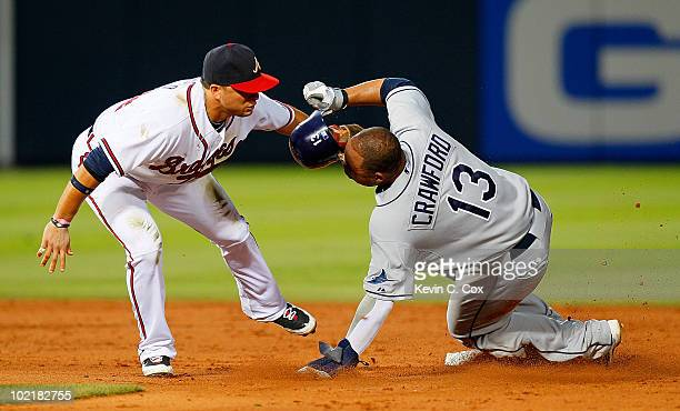Martin Prado of the Atlanta Braves tags out a sliding Carl Crawford of the Tampa Bay Rays at second base at Turner Field on June 17 2010 in Atlanta...