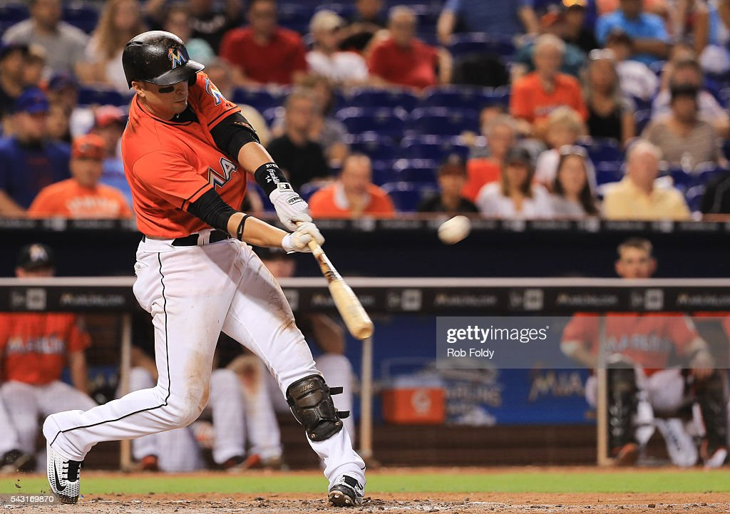 <a gi-track='captionPersonalityLinkClicked' href=/galleries/search?phrase=Martin+Prado&family=editorial&specificpeople=620159 ng-click='$event.stopPropagation()'>Martin Prado</a> #14 of the Miami Marlins hits a 3 RBI double during the eighth inning of the game against the Chicago Cubs at Marlins Park on June 26, 2016 in Miami, Florida.