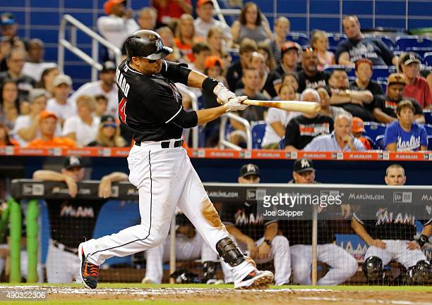 Martin Prado of the Miami Marlins hits a twoRBI single in the fifth inning against the Atlanta Braves at Marlins Park on September 27 2015 in Miami...