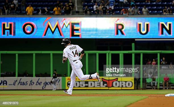 Martin Prado of the Miami Marlins rounds the bases after hitting a solo home run during a game against the Pittsburgh Pirates at Marlins Park on...
