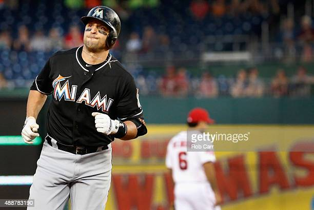 Martin Prado of the Miami Marlins rounds the bases after hitting a two RBI home run against the Washington Nationals in the first inning at Nationals...