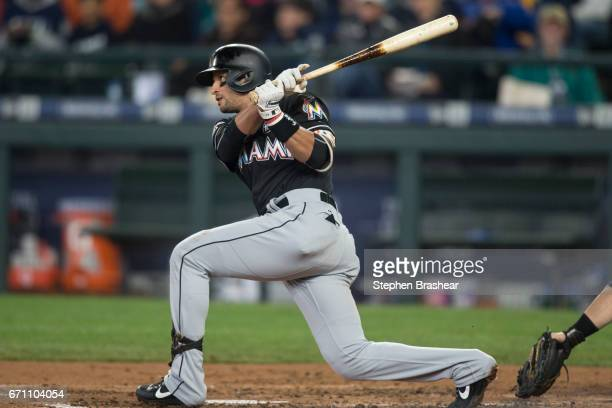 Martin Prado of the Miami Marlins takes swing during a game against the Seattle Mariners at Safeco Field on April 19 2017 in Seattle Washington The...