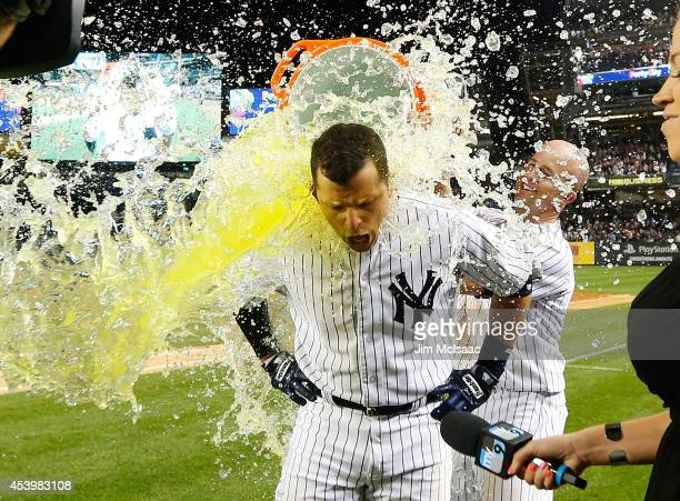 Martin Prado of the New York Yankees has Gatorade dumped on him by teammate Brett Gardner as they celebrate Prado's ninth inning game winning hit...