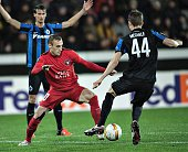 Martin Pusic of FC Midtjylland and Brandon Mechele of Club Brugge vie for the ball during the UEFA Europa League group D football match between FC...