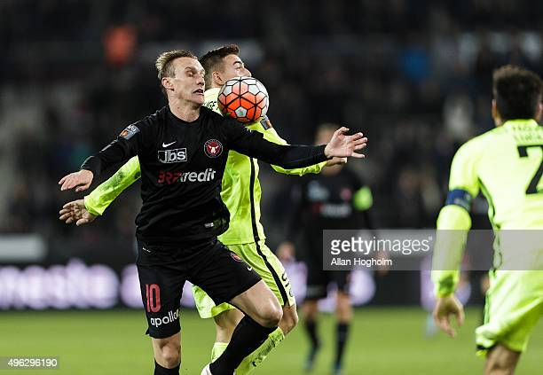 Martin Pusic of FC Midtjylland and Casper Nielsen of Esbjerg fB compete for the ball during the Danish Alka Superliga match between FC Midtjylland...