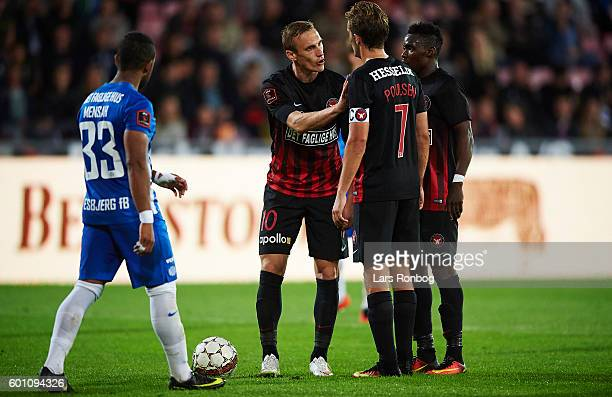 Martin Pusic of FC Midtjylland and Jakob Poulsen of FC Midtjylland in discussion about who will kick the penalty during the Danish Alka Superliga...